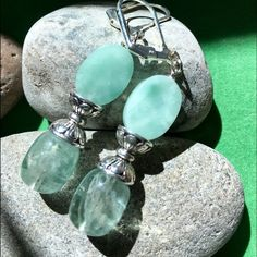Silver Claiming Green Stone Earrings Very pretty charming green stone with glass green bread and silver spacing bead on a lever back earrings. LalasjewelryDesign Jewelry Earrings