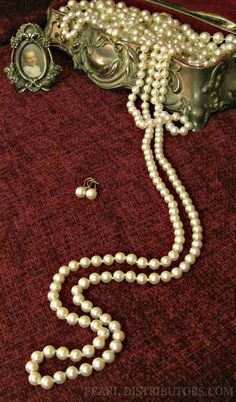 Long pearls in antique jewelry box