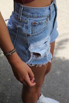 Crop Top, High-Waisted Denim Shorts, Converse, Bracelet.