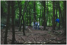 The groom and his best men prep the forest ceremony area