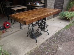 RUSTIC DINING TABLE with vintage singer sewing machine treadle.Handmade from reclaimed timber finished in dark oak briwax x Reclaimed Furniture, Reclaimed Timber, My Furniture, Antique Sewing Machine Table, Antique Sewing Machines, Rustic Table, A Table, Dining Table, Singer Sewing Tables