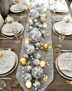 New Year's Eve Table: Be inspired by a disco ball center piece candles and a collection of clocks. This elegant table is full of wow factor! New Year's Eve Table Silver Christmas Decorations, Christmas Table Settings, Christmas Diy, Silver Ornaments, Modern Christmas, Christmas Tables, Purple Christmas, Coastal Christmas, Diy Ornaments