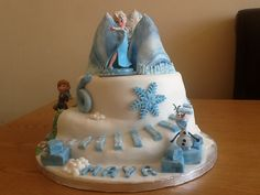Elsa, Anna and Olaf birthday cake Disney Frozen theme  See a close up of the Anna in summer section of the cake here  http://pinterest.com/pin/322570392033413344/