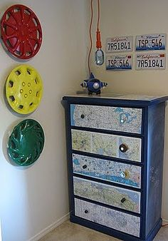 Map Dresser {decoupage}A plain dresser gets a makeover with old maps, some decoupage, and chalkboard paint! Idea for round lamps