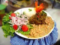 "In Peru, Carol loves seco de cabrito con frijoles with a cold ""Chicha Morada""...yummy!"