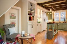 Farmhouse Kitchen by New England Design Elements All paint by Benjamin Moore: walls: Amulet; trim: Cappuccino Froth; ceiling: Plantation; soffit and wall with storage bench: Wicker Basket