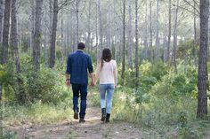 from behind: lovely romantic couple in to the forest by guillefaingold | Stocksy United