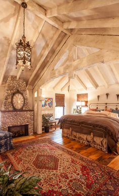 I want this bedroom! Love the exposed beam ceiling, the color, the light fixture and most of all the fireplace!