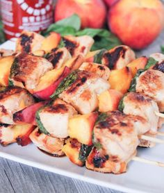 Sriracha glazed grilled chicken skewers with peaches and basil