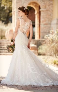 This designer fit and flare wedding gown from Essense of Australia is made from romantic lace and Regency organza and features bold Diamante beading on its cap sleeves and neckline. The back features illusion lace and zips up with ease under crystal buttons.