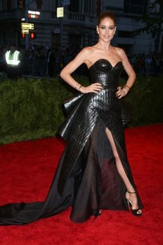 Met Ball Gowns That SLAYED ~  Doutzen Kroes — We can't imagine the sweet-faced Kroes ever working up a scowl worthy of her incredible custom Theyskens' Theory leather-and-organza gown, but we forgive her. The vinyl-look quilted creation is so true to the punk DNA — turning cheap-looking objects into high art — we think that Theysken and Kroes did the theme proud.