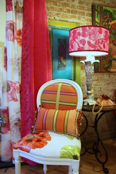 Hand painted chairs in a french theme. You can order painted canvas fabric to upholster your own chair. They can be totally custom mades to work with your decor. These chairs sold for 900.00 a chair Designers Guild silk lampshade 300.00