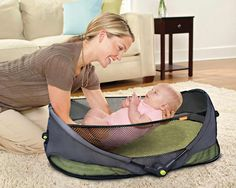 Portable bassinet -- ten times better solution than traveling with a pack n play! Brica Fold N' Go Travel Bassinet: Baby $40
