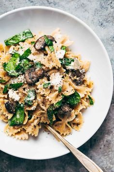 Date Night Mushroom Pasta with Goat Cheese - swimming in a white wine, garlic, and cream sauce. Perfect for a date night in! #pasta #goatcheese #dinner