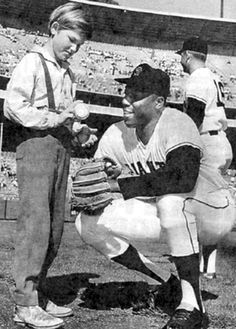 "Young Kurt Russell chats with SanFrancisco Giant's star Willie McCovey at Candlestick Park. Kurt's dad, actor Bing Russell, an ex-minor league baseball player, coached Kurt's Little League team. After high school graduation in '69 Kurt played minor league ball until '73. A promising big league prospect as a second baseman in the California Angels organization, Kurt was leading the Texas League in hitting when he tore his rotator cuff, ending his baseball career. Kurt starred on TV's ""Travels…"