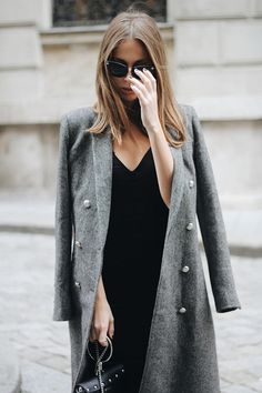 Black straight v-shaped neck dress with grey big button coat on it. #StreetFashionNYC #SpringStreetStyleNYC #SpringFashion