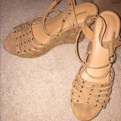 Tan Wedges Like new. Only worn about 2 times. I am a size 8 and theses it perfectly but bottom of shoe says size 9. So so cute but don't have much to wear with, can be worn casually with jeans or nice dress :) almost suede material, very comfy. Target Shoes