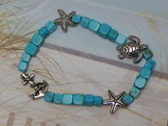 Sealife Turquoise Howlite Stretch Bracelet, Starfish, Sea Turtle, Anchor by SeagrassJewelry on Etsy
