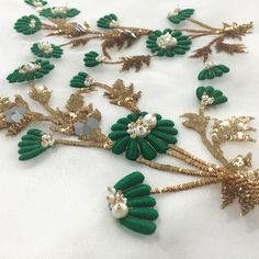 Flower bunches in emerald green and dazzling gold float on a white organza Zardozi Embroidery, Tambour Embroidery, Couture Embroidery, Embroidery Motifs, Hand Embroidery Designs, Ribbon Embroidery, Hand Work Design, Lesage, Gold Work