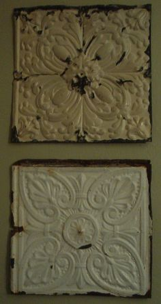 Old tin ceiling tiles become shabby wall art.