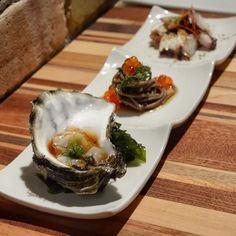 Hama Hama oyster with ponzu and wasabi. Soba noodles with shiso and ikura. Tako tataki.