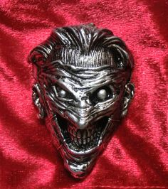 death of the family metal joker NAG nikos dresios jewelry