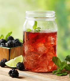 Garnish Ole Smoky's Blackberry Moonshine with sprigs of mint and lime slices.