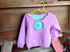 Refashioned sloppy joe with layered upcycled fabric flower Sloppy Joe, Refashion, Fabric Flowers, Upcycle, Range, Graphic Sweatshirt, Sweatshirts, Sweaters, Handmade