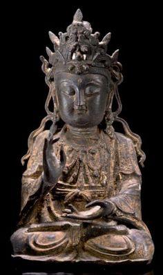 CHINA Beautiful figure sitting cross-legged goddess representing Kwanhin bronze with brown patina and gilt hightlights MING Dynasty sixteenth century H 29 cm