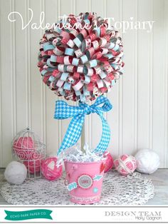 How to make a Paper Ribbon Topiary.  This one is for Valentine's Day but a Spring Topiary would look great too!