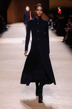 Officer-style coat, tank top and skirt in blue-black double-faced wool and silk knit Rocabar stripes, boots in black suede goatskin #hermes #hermesfemme #womenswear #fashion