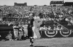 April 15, 1958 at Seals Stadium: Willie Mays takes the field for pregame introductions at the inaugural MLB game in California.  Giants ended up beating the Dodgers 8-0.