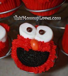 Elmo Cupcakes! Half an oreo, marshmallows, and an orange peanut M&M!