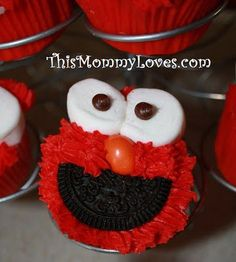 Elmo Cupcakes! Half an oreo, marshmallows, and an orange peanut M&M!