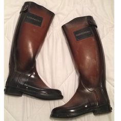 """New Burberry Rain boots.women size 7 make offer! New without box Burberry women's rain boots.size 7. Color is rusted brown as shown on the photo. Color is distressed where some parts are faded and it is made like that . Looks like riding boots. Has a back zipper closure With button snap on the top back. The top sides says Burberry and bottom back of heel also says Burberry . Length of the boots are 18""""  close to knee high . Burberry Shoes Winter & Rain Boots"""