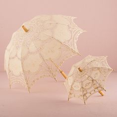 Antiqued Battenburg Lace Parasol Ivory Dress up your ceremony or reception with these romantic lace parasols. Whether carried down the aisle or incorporated with the reception décor, the delicate patt