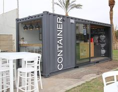 A design competition has inspired Israeli interior designer Liat Eliav to bring her winning shipping container cafe design to life. Known simply as The Container, the mobile coffee shop was built in just five weeks. Small Coffee Shop, Coffee Shop Design, Container Buildings, Container Architecture, Kiosk Design, Cafe Design, Interior Design, Retail Design, Shipping Container Restaurant