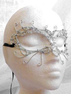 Silver venetian style wire mask, handmade. $170.00, via Etsy.
