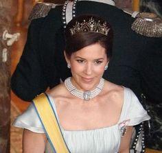Crown Princess Mary wearing a PHOTSHOPPED Alexandrine Drop tiara.  That tiara is the personal property of Alexandra, Countess of Fredriksborg.