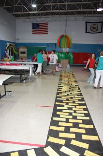 Principal/Teacher Retirement Party - Wizard of oz theme - made a yellow brick road with signatures of all the students in the school on yellow rectangles.