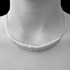 Silver Wire Chunky Choker Necklace -  This stunning contemporary Silver Wire Chunky Choker Necklace, with its intricately hand crafted coiled wire centre piece is a real statement design. #Otisjaxon #Jewellery
