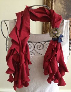 The spiral scarf has been a best seller at a local boutique! The burgundy spiral scarf with a navy blue band and handmade brooch with a fish jewelry accent is made from two recycled t-shirts. It can be worn loose on both sides or tied for a shorter look. This scarf really makes a plain white t-shirt or tank lovely! It is perfect for any season! $30.00 http://www.etsy.com/listing/96412000/burgundy-spiral-scarf-with-navy-blue?ref=v1_other_2