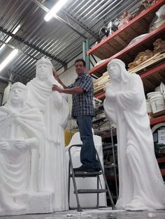 Once the large nativity sculptures are milled and assembled, we then have to do some hand carving on the foam to define any areas which the milling process cannot cut out.  Paul carving on the wisemen.  www.bignativity.com