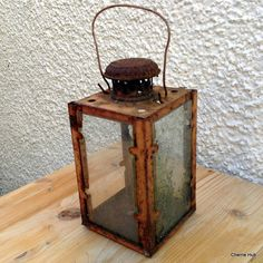 Rustic Square Lantern with a Handle  From Cherrie Hub, online shop selling rustic furniture with coastal soul