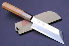 "YOSHIHIRO- Shiroko-Kasumi Kenmuki Sashimi Chef Knife 4.75"" 120mm - MADE IN JAPAN by YOSHIHIRO. $179.99. BOLSTER: Water Buffalo Horn (BOLSTER COLOR -VARIES) / Handle Material: Magnolia. Grade: Kasumi/ Knife Type: Kenmuki Knife. Blade: Single-Edged /Blade Length: 4.75"" (120mm). Steel Type: Shiroko (white steel) High-Carbon Steel. Hardness Rockwell C scale: 62-63. Kasumi means mist in Japanese. The border of the blade on a Kasumi has beautiful waves that look like a mist. It is..."