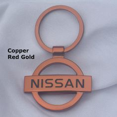 Nissan Gold, Black or Blue Tone Enamel hand coated keyring Keyfob keychain Made from high quality base metal die cast parts plated, hand polished and hand coate