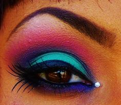 Teal, Purple, and Pink   I think this should be the manditory eye make up for everyone attending the festivities, regardless of gender!