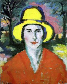 Mujer con sombrero amarillo
