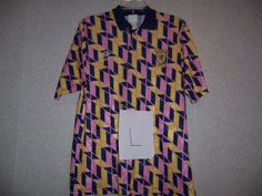 This football shirt is from Umbro's archive. We've been slowly trying to collect and catalogue all our old kits (see our blog post for more details). If you know anything more about this shirt (such as which season it's from), please help us out by adding comments and tags.