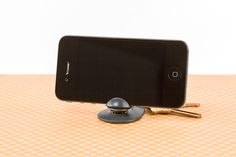 The Tiltpod is an iPhone tripod that hangs on your keychain. Love!